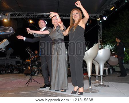 ANKARA/TURKEY-JUNE 8: Turkish Radio and Television-TRT's folk music singers (from left) Ali Cakar, Emine Ata and Selma Gecer at the stage during the
