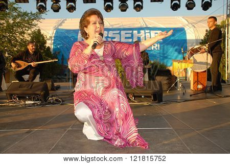 ANKARA/TURKEY-JUNE 7: Turkish Radio and Television (TRT)  folk music singer Emel Tascioglu at the stage during the
