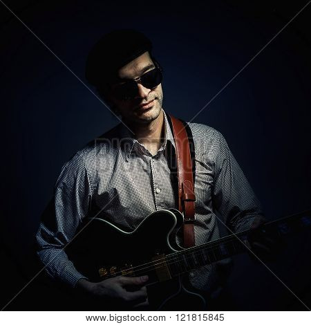 Jazz Musician Playing A Guitar
