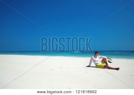 Freedom Beach. Relax. Successful Handsome Man In Hat Resting On Exotic Seashore With Blue Water And