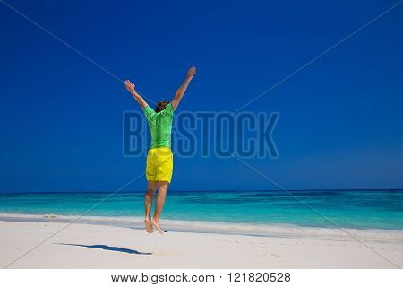 Human. Freedom Beach Summer Holiday Concept. Handsome Young Man Jumping On A Tropical Beach, Relax O