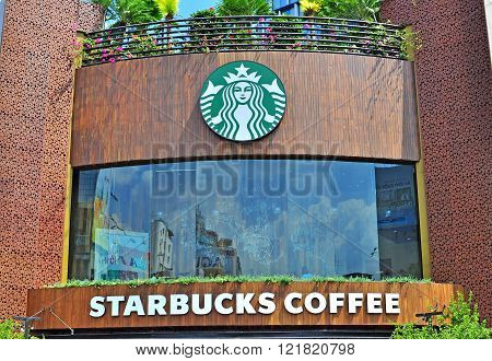 HO CHI MINH VIETNAM - MARCH 6: Starbucks coffeeshop in Ho Chi Minh city centre on March 6 2015. Ho Chi Minh is the secord largest city of Vietnam.