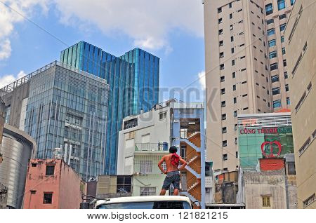 HO CHI MINH VIETNAM - MARCH 24: Man looking at property construction in Ho Chi Minh city centre on March 24 2015. Ho Chi Minh is the secord largest city of Vietnam.