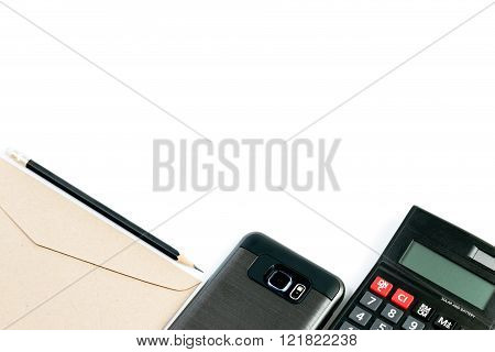 White Copy Space With Calculator, Smartphone, Envelopes And Pencil Beautifully Arranged Orderly