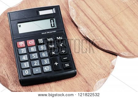 Calculator On Background Two Wood Texture