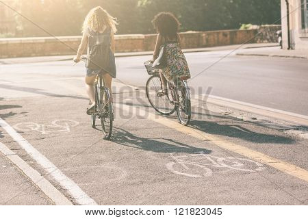 Couple Of Friends With Bicycles On Bike Lane.