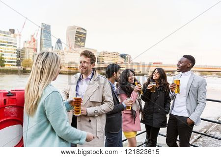 Business Group Drinking Beer After Work In London