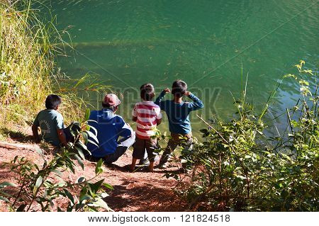 Lagunas de Montebello National Park Chiapas Mexico - January 4 2015: Man and his kids spend time by the laguna Esmeralda in Chiapas Mexico on January 4 2015