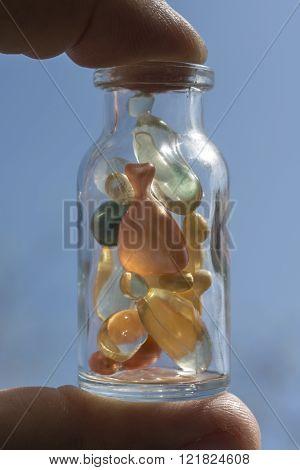 Gel capsules in a glass bottle