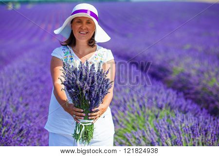 Woman with bouquet of lavender flowers