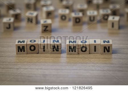 Moin Moin Written In Wooden Cubes