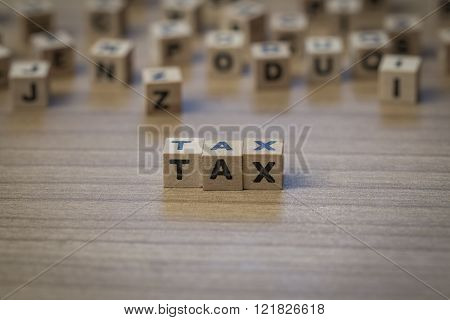 Tax Written In Wooden Cubes