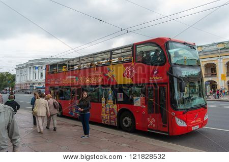 SAINT PETERSBURG, RUSSIA, - AUGUST 16, 2015: Citysightseeing bus on a bus stop in St. Petersburg. Tourist bus is a popular transport for tourists in Petersburg.
