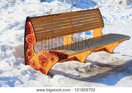 Berdsk Novosibirsk region Siberia Russia - March 13 2016: wooden bench in a city Park with a picture in the Russian style Khokhloma