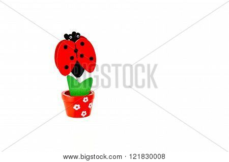 Wooden flower and lady bug isolated on white background