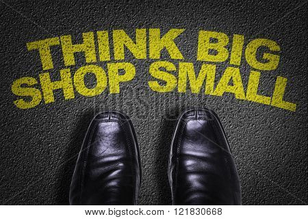 Top View of Business Shoes on the floor with the text: Think Big Shop Small