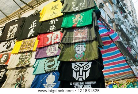 HONG KONG CHINA, - FEB 9: Portrait of USA president Barack Obama as a Chinese leader in a mass of t-shirts on street market on February 9, 2016. More than 47 million tourists visit Hong Kong annually