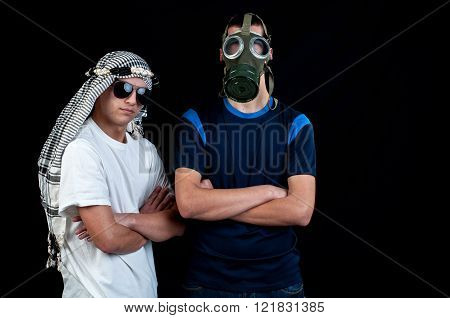 Young man with sunglasses and a young man with gas mask