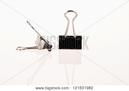Two Black Binder Clips For Paper On White Background