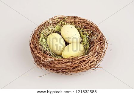 liyyle easter quail eggs in brown bascket
