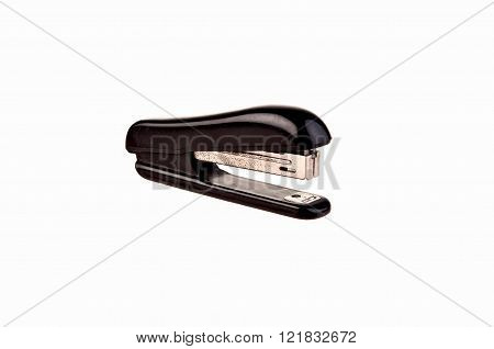 old rusty black stapler on white background