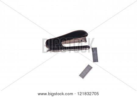 rusty stapler whit staples on white background