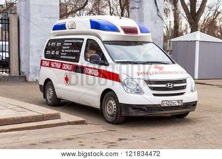 SAMARA RUSSIA - MARCH 13 2016: Ambulance car parked up in the street. Text in russian: