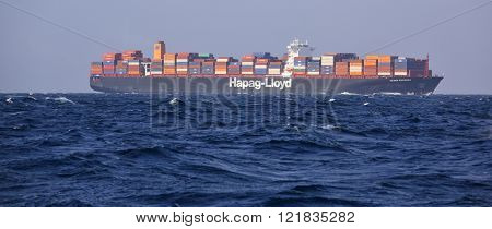 BAB-EL-MANDEB STRAIT- GULF OF ADEN  FEBRUARY 05, 2016: Hapag-Lloyd Cargo Container Ship Ulsan Express in high seas. She has 366m length overall and beam of 48m. Her gross tonnage is 142295 tons.