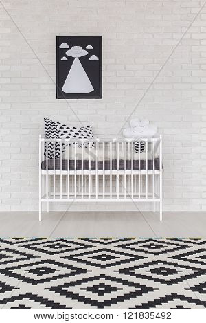 Shot of a crib in a black and white room