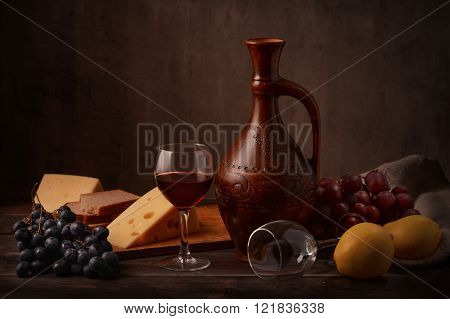 Still life with wine, grape and cheese