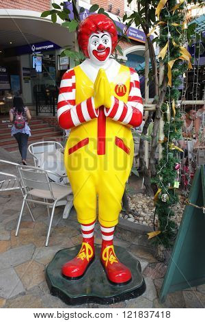 BANGKOK, THAILAND - DECEMBER 12, 2011 : Ronald McDonald in front of a McDonald's restaurant in the city centre in Bangkok