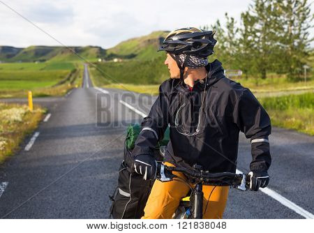 Happy biker on backdrop of mountains in Iceland