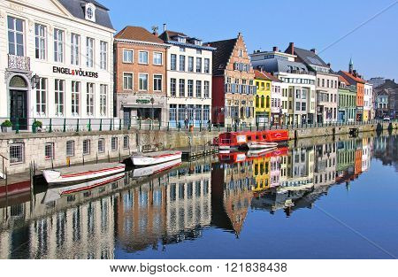 GHENT BELGIUM - MARCH 22: Boats on the waterfront of Ghent city center on March 24 2012. Ghent is a city and a municipality located in the Flemish region of Belgium. It is the capital and largest city of the East Flanders province.