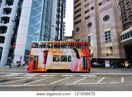 HONG KONG CHINA - JUNE 5: Double Decker tram goes by the Causeway Bay street in Hong Kong on June 5 2012. Hong Kong is one of the two Special Administrative Regions of the People's Republic of China