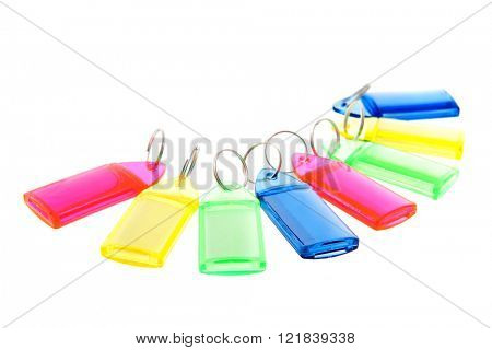 Row colorful key rings isolated over white background
