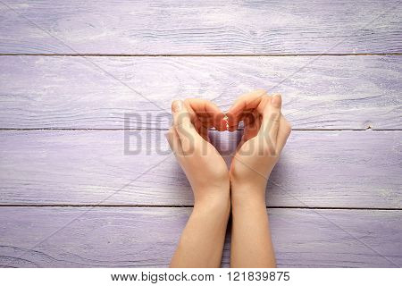 Woman Hand Making Sign Heart On Wooden Background With Copy Space