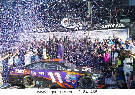 Daytona Beach, FL - Feb 21, 2016: Denny Hamlin celebrates his win in Victory Lane  during the Daytona 500 weekend at the Daytona International Speedway in Daytona Beach, FL.
