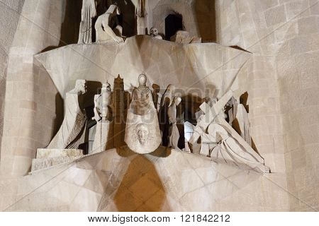 Barcelona, Spain - November 9, 2015: Facade of Sagrada Familia at night. The church is designed by architect Antoni Gaudi and still incomplete. This facade is dedicated to the Passion of Christ.