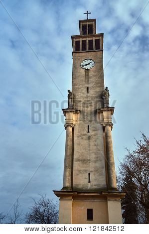 Neoclassical campanile with statues and clock in Poznan