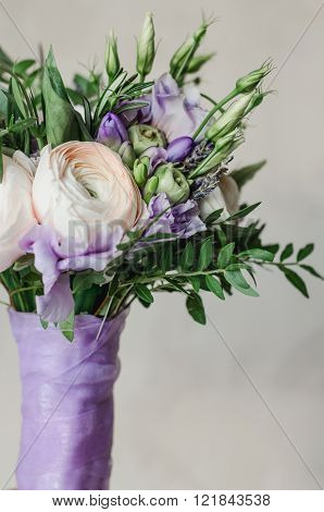 Beautiful Rustic Wedding Bouquet Of Violet And Ranunculus Lavender Flowers With Satin Lilac Tape On
