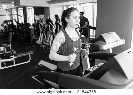 Sports Woman Is Running On The Treadmill
