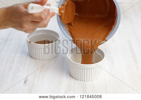 Raw Dough Is Poured Into A Ceramic Mold For Baking