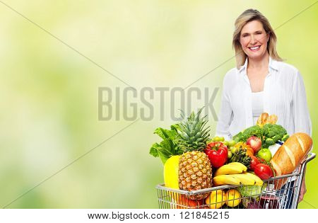 Beautiful senior woman with grocery shopping cart.
