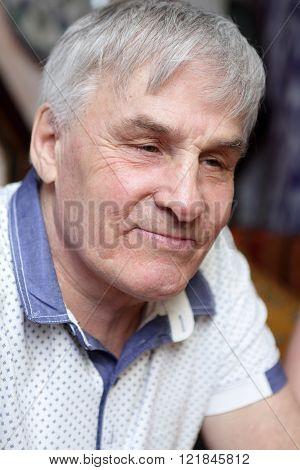Portrait of a smiling senior man in cafe
