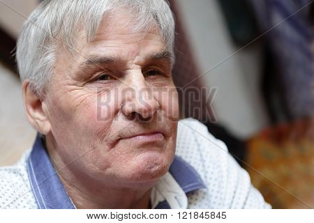 Portrait of a thinking senior man in cafe