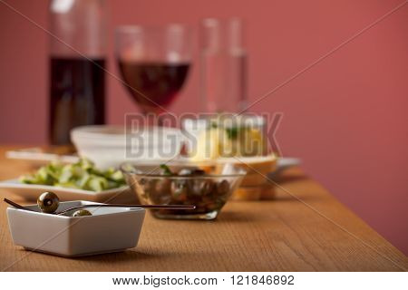 antipasti misti on a wooden table with wine