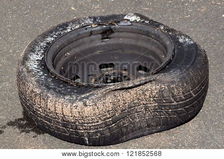 Dirty Damaged Tire And Rim After Hitting Curb