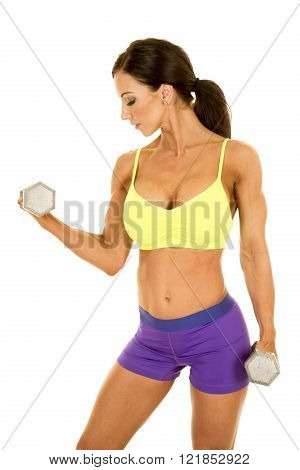A woman working out with weights, showing off her muscles.