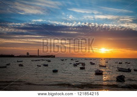 beautiful sunset at la caleta in cadiz spain