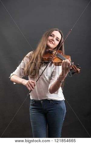 portrait of a beautiful violinist with long hair